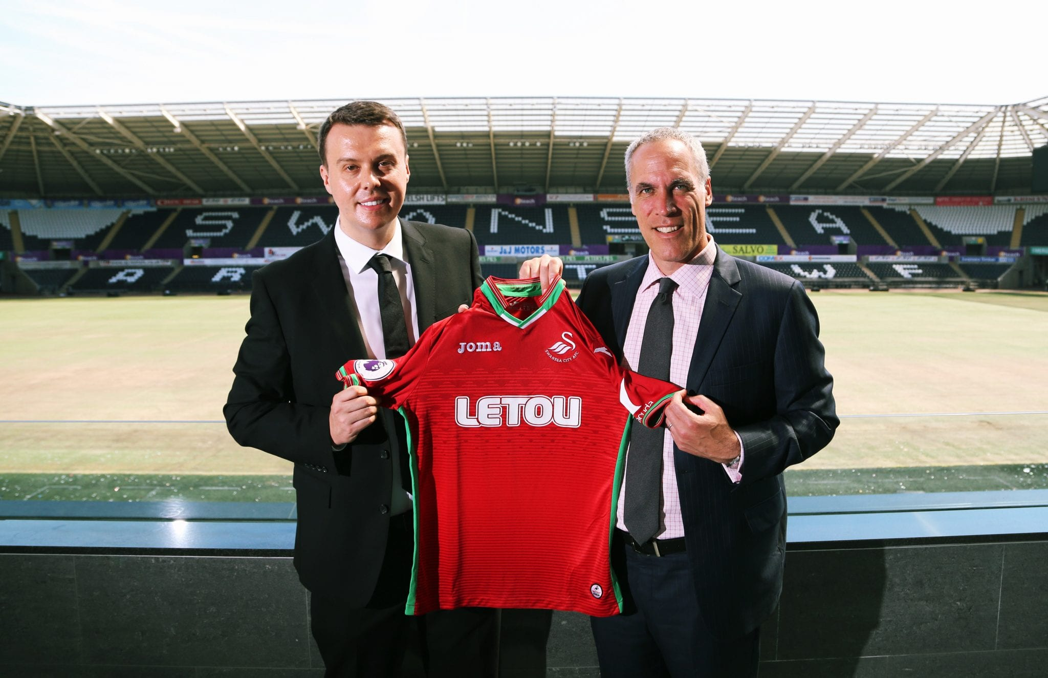 Pictured L-R: Paul Fox, CEO of Letou with Chris Pearlman, COO of Swansea City FC. Monday 19 June 2017 Re: Swansea City FC launch their new home and away kits and announce Letou as their new sponsor at the Liberty Stadium, Swansea, Wales, UK.