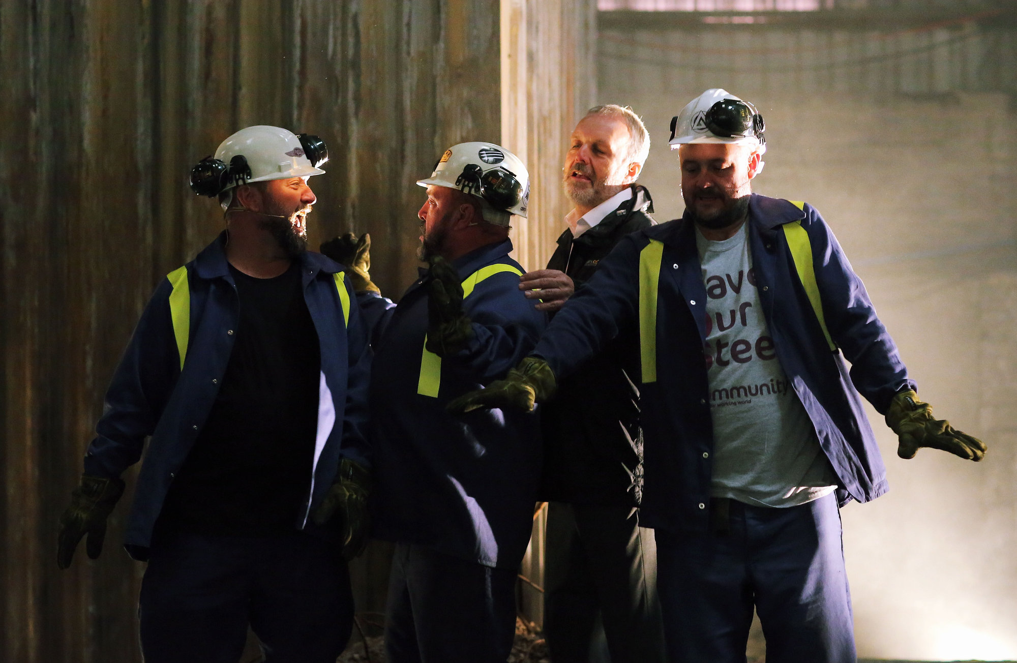 "Pictured: The four main characters perform a dance scene Re: Press rehearsal of ""We'Re Still Here"", a play created by Rachel Trezise, Common Wealth and the National Theatre Wales about steelworkers, which will be performed in Byass Works, a disused industrial unit, in Port Talbot, south Wales, UK."