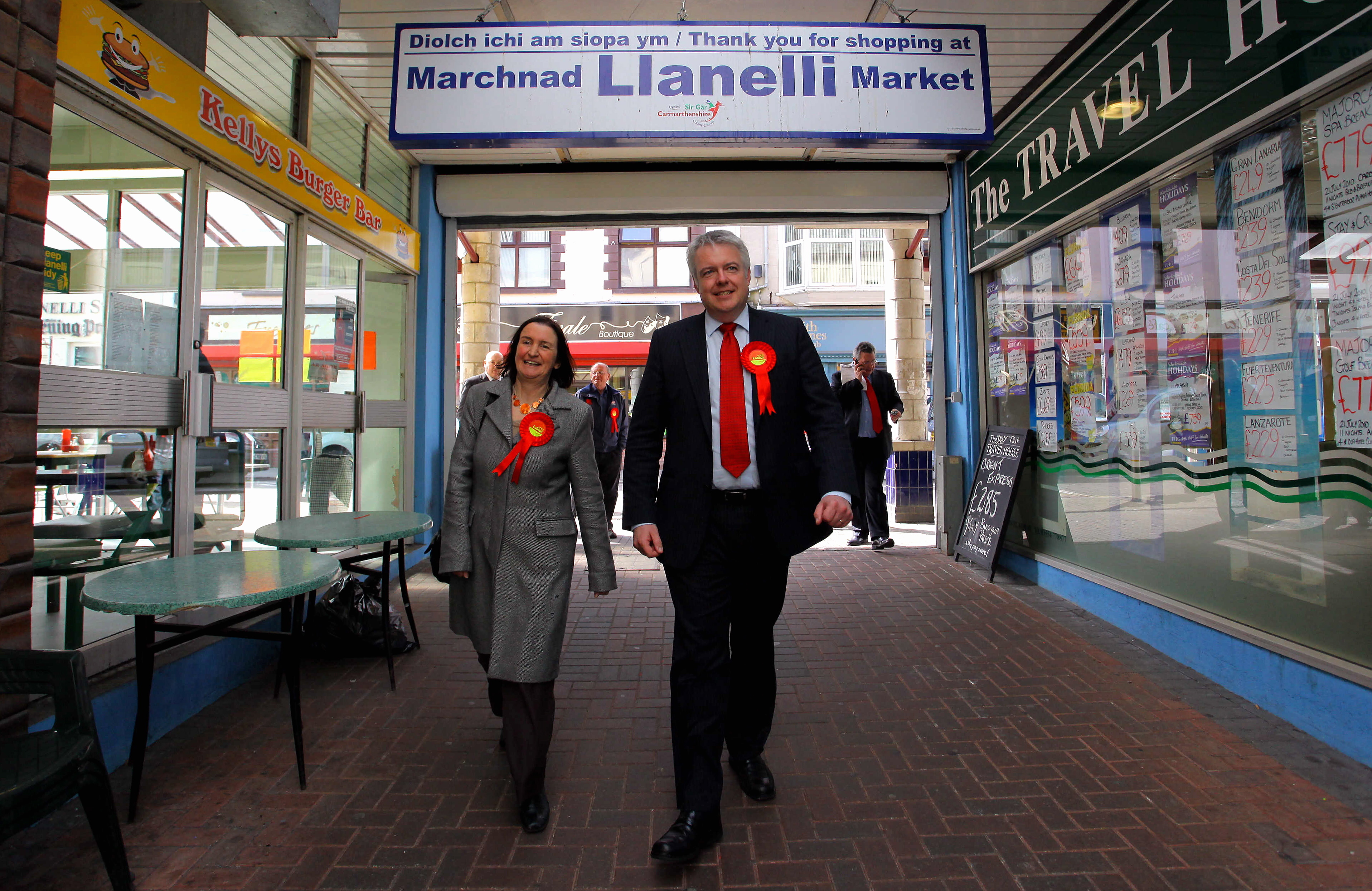 Pictured: Nia Griffiths and Carwyn Jones in Llanelli Market Re: Nia Griffiths MP canvassing shoppers for Labour's pre election campaign, in the town centre of her constituency of Llanelli in Carmarthenshire west Wales, with First Minister for Wales Carwyn Jones. Thursday 08 April 2010