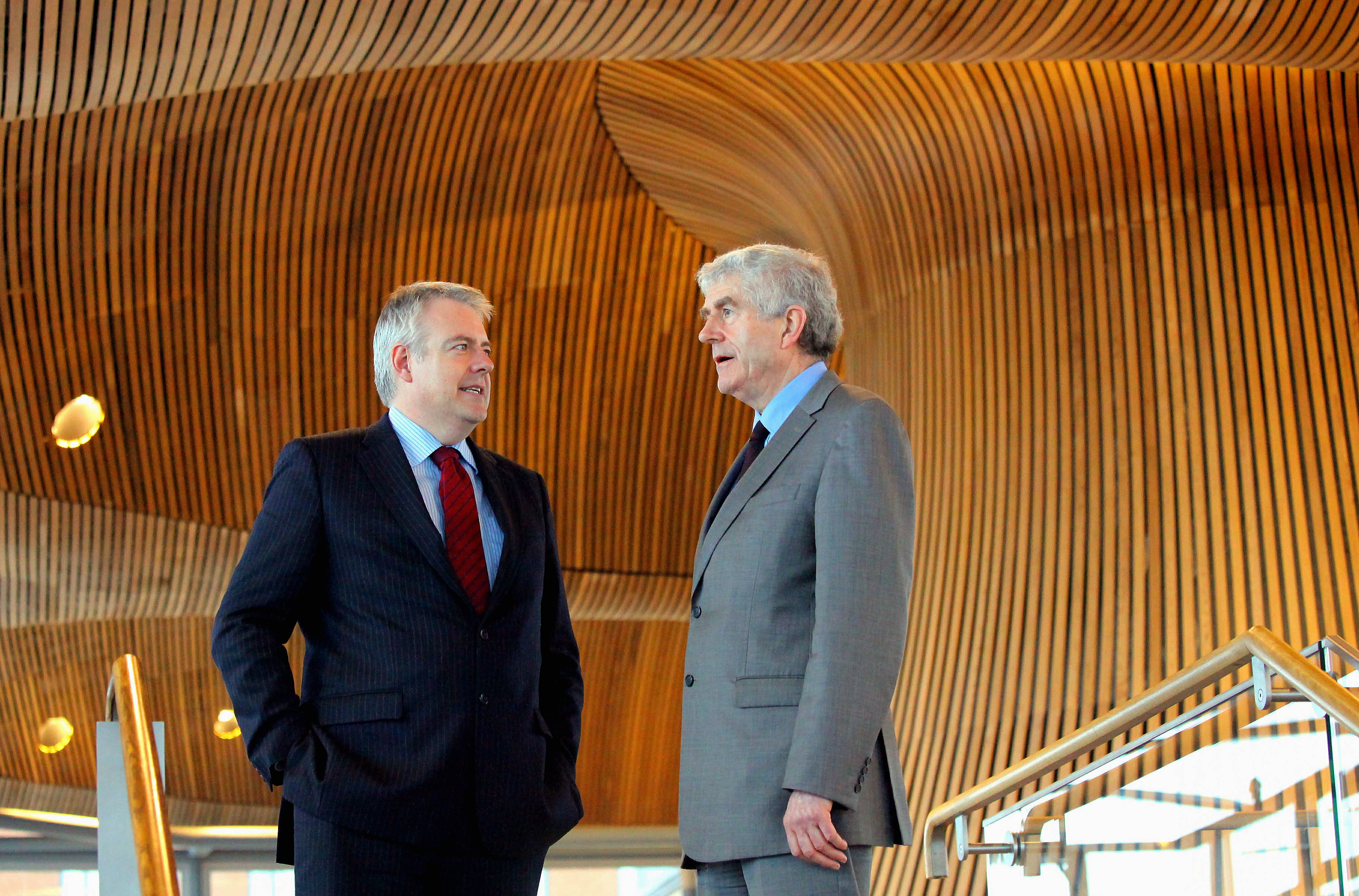 Rhodri Morgan (R) with successor Carwyn Jones (L) in the Senedd Cardiff Bay. Last day in office for First Minister for Wales Rhodri Morgan at the Welsh Assembly Government where he took part in First Minister Questions at the Chambers in the Senedd at Cardiff Bay for the last time, to be succeeded by Carwyn Jones Assembly Member for Bridgend.