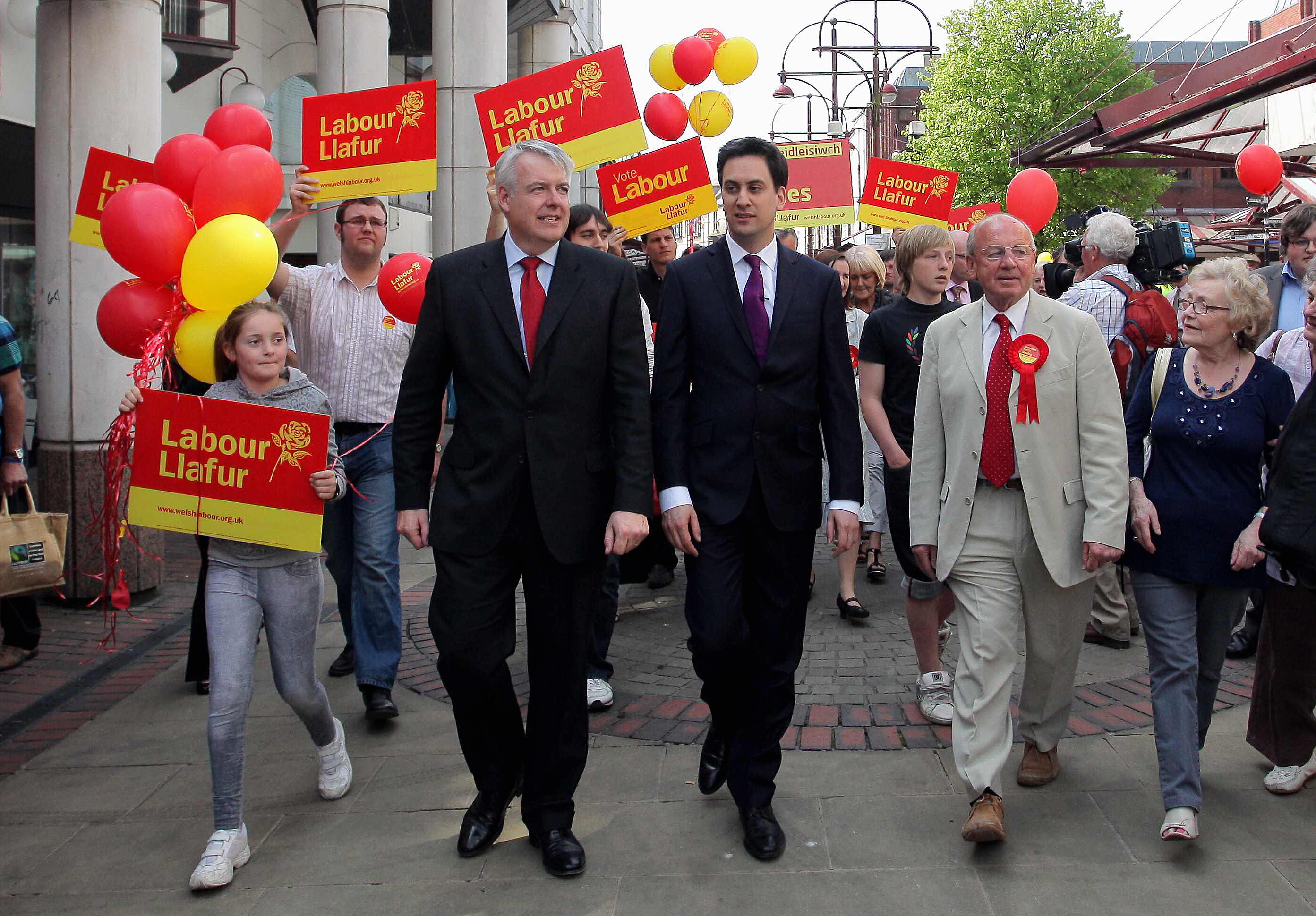 Pictured: Labour leader Ed Miliband (C) strolls through Llanelli town centre with First Minister for Wales Carwyn Jones (L) and Welsh Assembly candidate for Llanelli Keith Davies (R). Wednesday 20 April 2011 Re: Labour Party leader Ed Miliband was touring south and west Wales today in support to candidates of the forthcoming Welsh Assembly election in May. He arrived by train to Swansea Railway Station where he was greeted by MP for Neath Peter Hain and he was then driven to Llanelli, Carmarthenshire where he toured in the city's enclosed market with local Labour candidate.