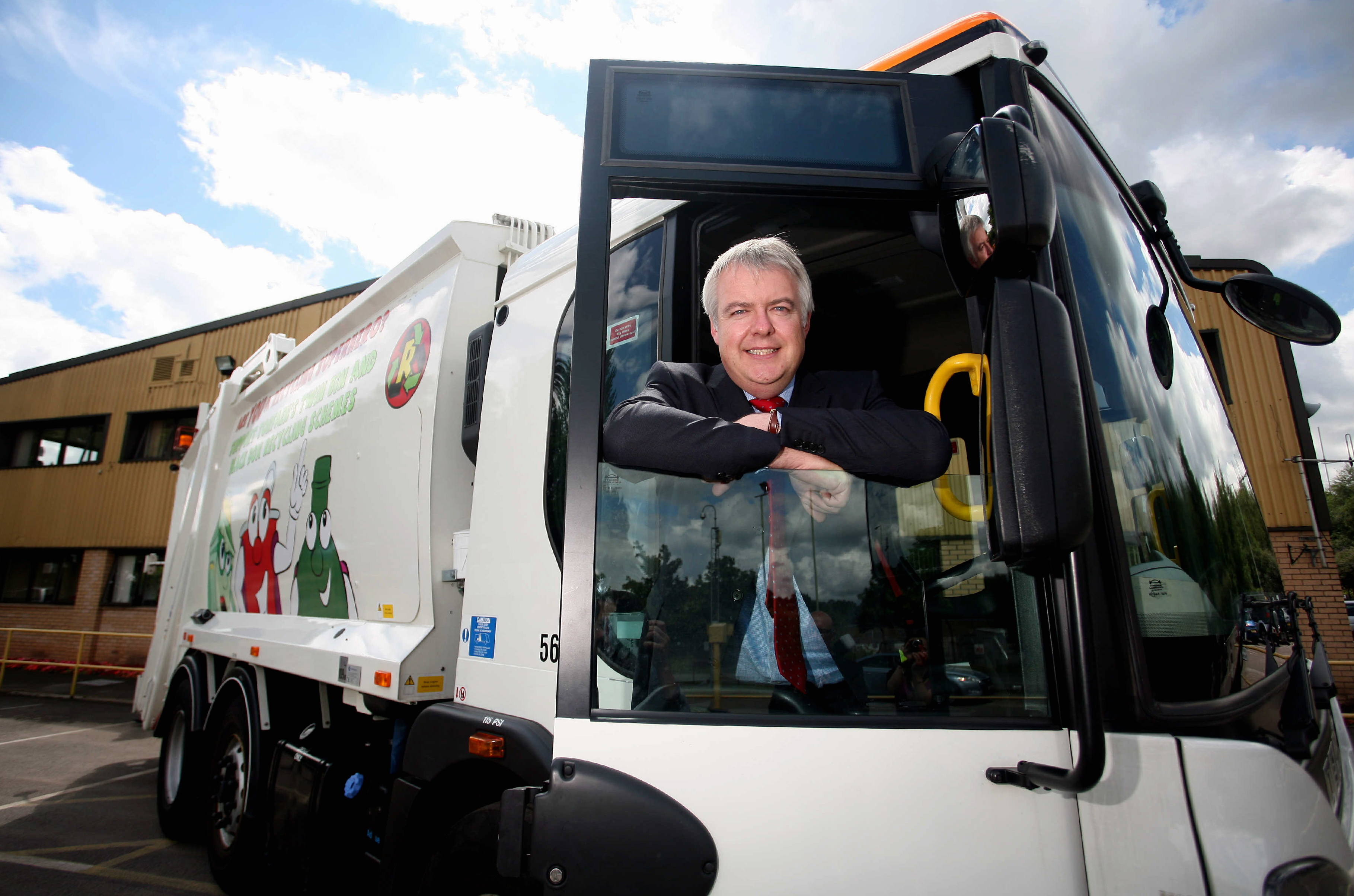 Pictured: First Minister for Wales Carwyn Jones in the cab of a refuse lorry. Thursday 22 July 2010 Re: The first minister of Wales, Carwyn Jones, is doing a tour speaking to public workers at the Neighbourhood Services department in New Inn near Pontypool where he was taken in a refuse lorry from the town's Civic Centre.